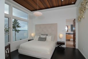 Modern Master Bedroom with George nelson small saucer lamp, Pottery barn lorraine tufted upholstered tall bed, flat door
