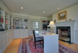 Traditional Home Office with stone fireplace, metal fireplace, Hardwood floors, can lights, Built-in bookshelf, Fireplace