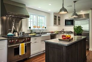 Traditional Kitchen with Complex granite counters, Farmhouse sink, L-shaped, Flat panel cabinets, Glass panel, Kitchen island