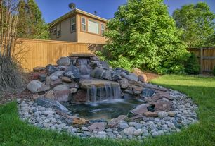 Traditional Landscape/Yard with Passion for Ponds - Creating a Waterfall, Fence, Pond