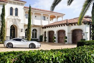 Mediterranean Garage with High ceiling, Double lancet window, Covered balcony, Exterior of villa, Arched wooden garage doors