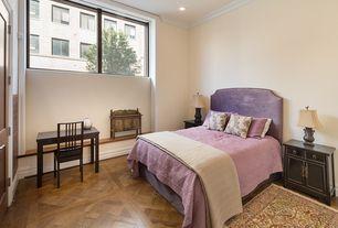 Traditional Guest Bedroom with Crown molding, Window seat, specialty door, Art desk, Hardwood floors