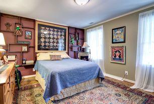 Eclectic Guest Bedroom with flush light, Built-in bookshelf, Hardwood floors
