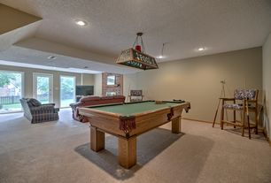 Traditional Game Room with French doors, Carpet, Exposed beam, Pendant light