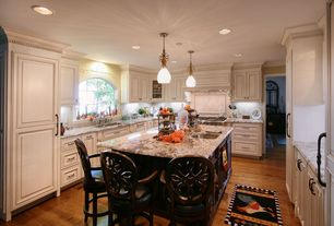 Traditional Kitchen with Glass panel, Complex granite counters, Kitchen island, Raised panel, Arched window, Flush, U-shaped