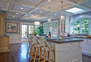 Traditional Kitchen with Hardwood floors, Parisian Bistro Woven Bar Stool by William-Sonoma Home, Arched window, Wainscotting