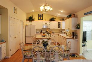 Tropical Kitchen with Raised panel, Formica counters, Breakfast nook, Glass panel, Kitchen island, Inset cabinets, Chandelier