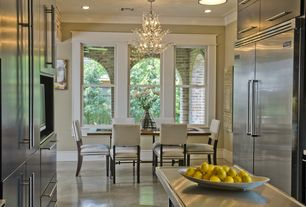 Traditional Dining Room with double-hung window, Standard height, Concrete floors, Chandelier, Crown molding, can lights