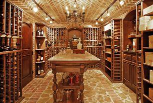 Traditional Wine Cellar with slate floors, flush light, Chandelier, Built-in bookshelf
