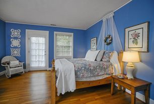 Traditional Guest Bedroom with French doors, Standard height, Hardwood floors, Crown molding, double-hung window