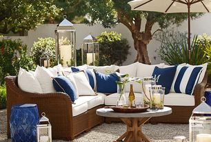 Traditional Patio with Fence, Extra Large Malta Lantern, Pottery Barn Palmetto All-Weather Wicker Sectional