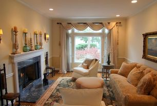 Traditional Living Room with Standard height, stone fireplace, Wall sconce, Fireplace, Casement, Chair rail, Hardwood floors