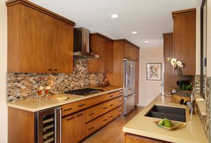 Contemporary Kitchen with Wine refrigerator, Corian absolute beige solid surface, Ceramic Tile, Galley, Flush