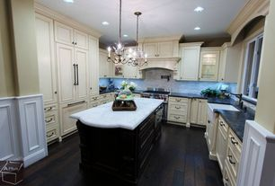 Traditional Kitchen with U-shaped, can lights, Glass panel, full backsplash, Complex marble counters, Hardwood floors, Flush