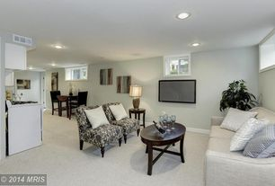 Contemporary Living Room with Casement, picture window, Carpet, can lights, Built-in bookshelf, Standard height, Paint
