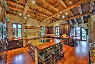 Mediterranean Kitchen with Paint 1, Flat panel cabinets, Arched window, flush light, Limestone counters, Exposed beam