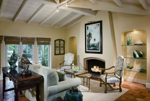 Mediterranean Living Room with flush light, Fireplace, insert fireplace, terracotta tile floors, picture window, High ceiling