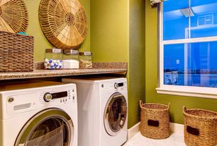 Eclectic Laundry Room with Concrete tile , Undermount sink, double-hung window, Paint, laundry sink, stone tile floors