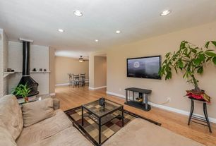 Traditional Living Room with Bamboo floors, Contours Mondavi Burgundy Rug, Tanner Cube Table, Painted brick