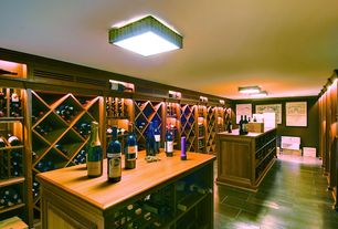 Contemporary Wine Cellar with Standard height, flush light, Crown molding, Built-in bookshelf, Concrete tile , can lights