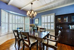 Traditional Dining Room with Chair cushion, Wood dining chair, Hardwood floors, Bay window, Exposed beam, Built-in bookshelf