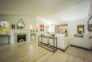 Contemporary Great Room with Exposed beam, Built-in bookshelf, flush light, Laminate floors