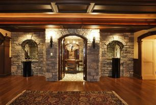 Mediterranean Wine Cellar with specialty door, Standard height, Chandelier, slate floors, Built-in bookshelf