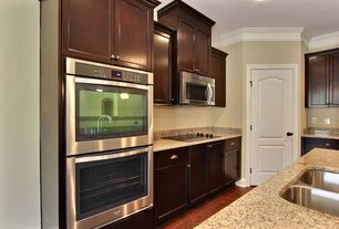 Traditional Kitchen with Oak - Whiskey 2 1/4 in. Solid Hardwood Strip, Flat panel cabinets, Simple Granite, L-shaped, Flush