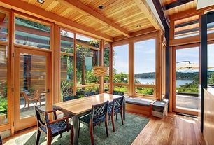 Craftsman Dining Room with picture window, can lights, Exposed beam, Hardwood floors, Pendant light, Standard height
