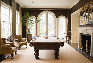 Traditional Game Room with Arched window, French doors, Crown molding, Cement fireplace, Hardwood floors