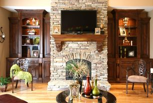 Traditional Living Room with Powell spider web back accent chair, Stacked stone fireplace, Built-in bookshelf, Wood mantle