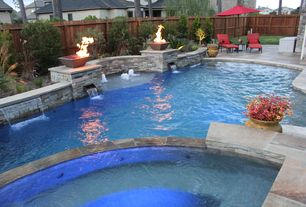 Traditional Swimming Pool with Fire feature, Pool with hot tub, Pool waterfall feature, Stone retaining wall