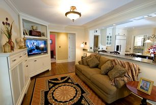 Traditional Living Room with Hardwood floors, flush light, Built-in bookshelf, Crown molding