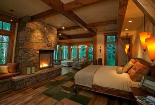 Rustic Master Bedroom with Eldorado Stone Rough Cut, Wall sconce, Exposed beam, Pendant light, flush light, French doors