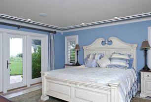 Traditional Master Bedroom with can lights, Crown molding, Standard height, travertine floors, picture window, French doors