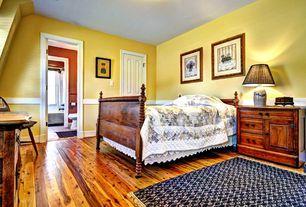 Country Guest Bedroom with Standard height, Hardwood floors, Chair rail, specialty door