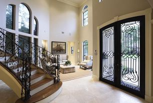 Mediterranean Entryway with High ceiling, French doors, Custom wrought iron stair railing, simple marble tile floors