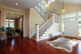 Traditional Staircase with Hardwood floors, Casement, Wall sconce, curved staircase, six panel door, Transom window