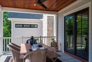 Traditional Porch with Wrap around porch, Deck Railing, picture window, exterior concrete tile floors, exterior tile floors