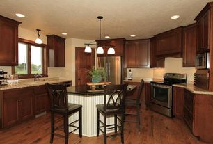 Traditional Kitchen with Simple granite counters, Breakfast bar, Simple Granite, Flat panel cabinets, specialty door, Flush