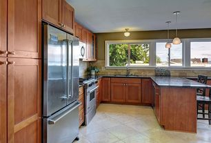 Traditional Kitchen with Flat panel cabinets, Soapstone counters, Limestone Tile, Undermount sink, European Cabinets, Flush