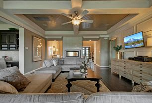 Contemporary Living Room with Ceiling fan, stone fireplace, Box ceiling, Crown molding, Fireplace, Hardwood floors