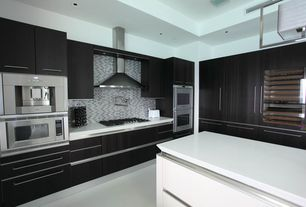 Contemporary Kitchen with Wall Hood, double wall oven, Pot filling faucet, Simple marble counters, built-in microwave, Flush