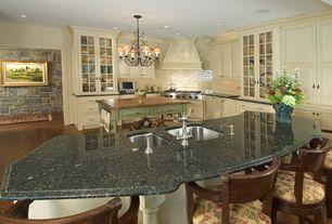 Country Kitchen with Breakfast bar, Eldorado Stone Rough Cut, Custom hood, Subway Tile, Glass panel, L-shaped, Raised panel