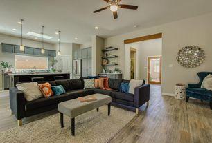 Modern Living Room with Hardwood floors, can lights, Standard height, Built-in bookshelf, Ceiling fan