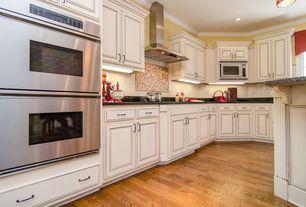 Traditional Kitchen with Large Ceramic Tile, U-shaped, built-in microwave, full backsplash, flush light, Soapstone counters