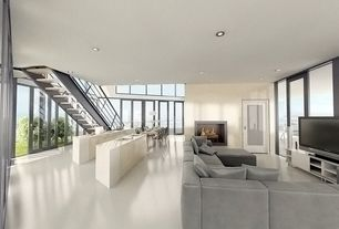 Contemporary Great Room with Fireplace, Cement fireplace, picture window, sliding glass door, Concrete floors, can lights