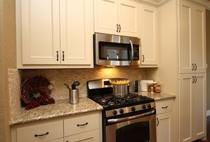 Country Kitchen with Stone Tile, Flat panel cabinets, One-wall, Simple granite counters, Inset cabinets, Limestone Tile