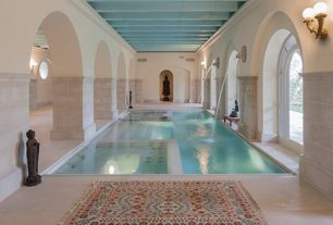 Traditional Swimming Pool with Arched window, exterior stone floors, Fountain