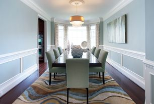 Contemporary Dining Room with Wainscotting, Hardwood floors, Chair rail, Armless upholstered dining chair, Crown molding